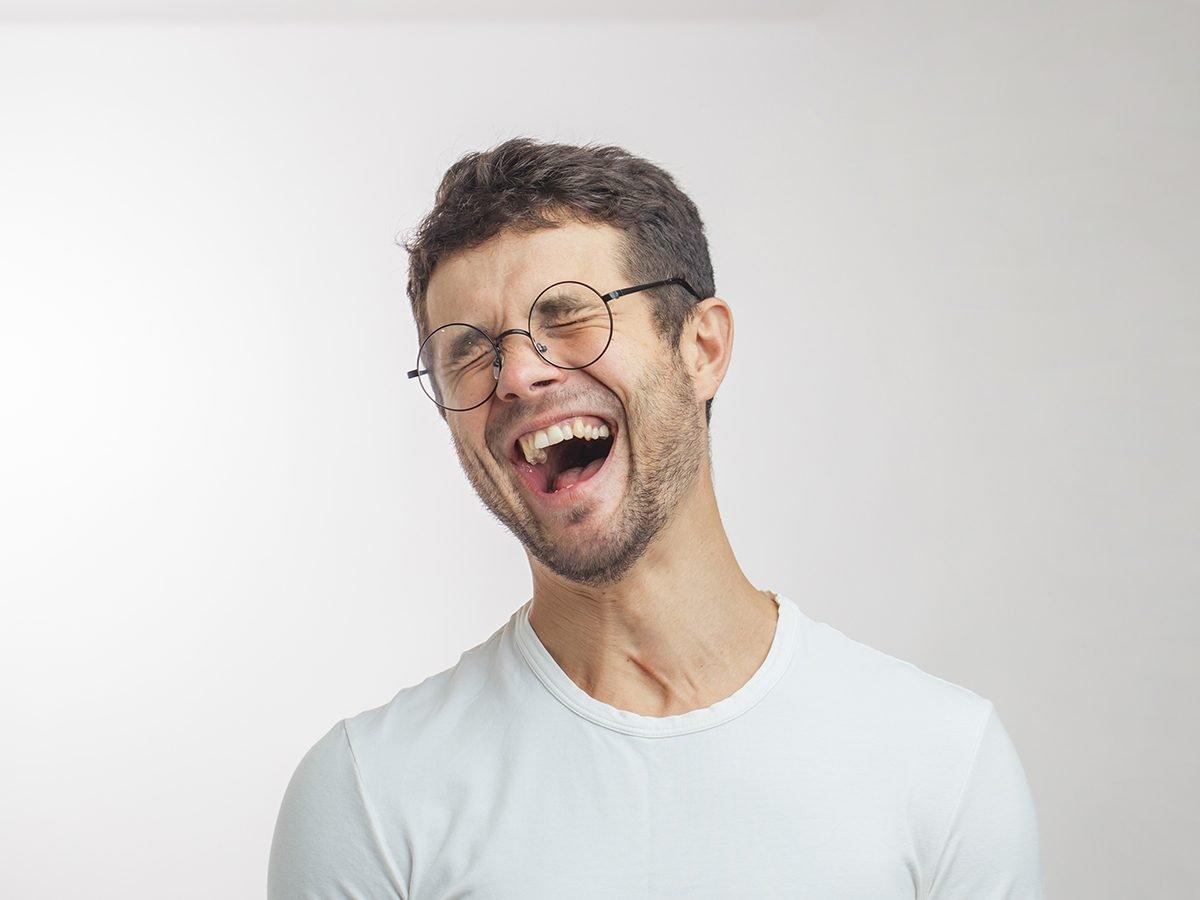 Best Readers Digest Jokes - Man In Glasses Laughing