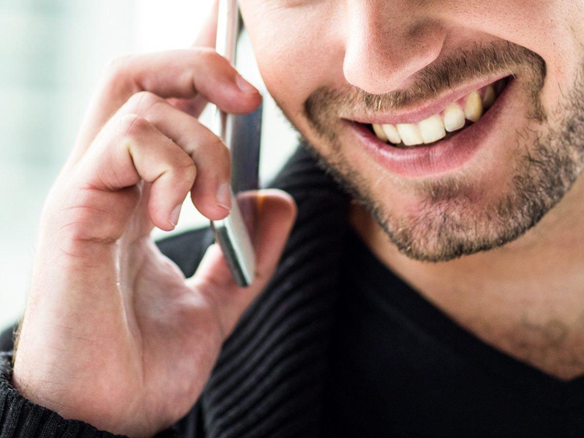 Best Readers Digest Jokes - Man Smiling On Phone