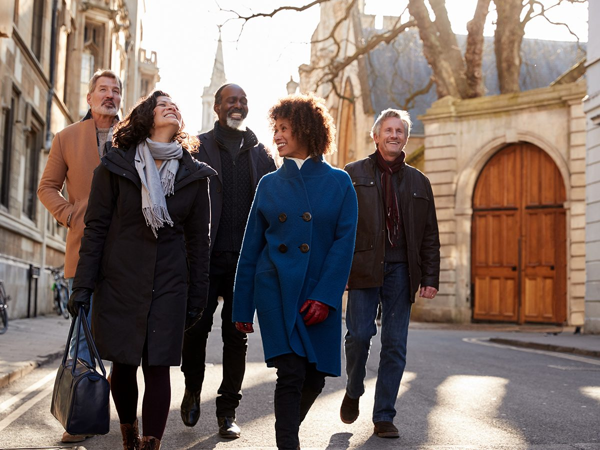 Pisces Trust - Group of friends walking through a city in fall together