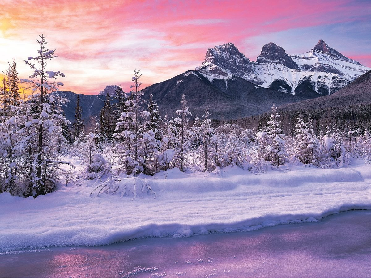 Sunset in winter Season by mountains.
