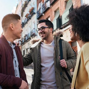 Zodiac Trustworthiness - Group of happy friends chatting in the street