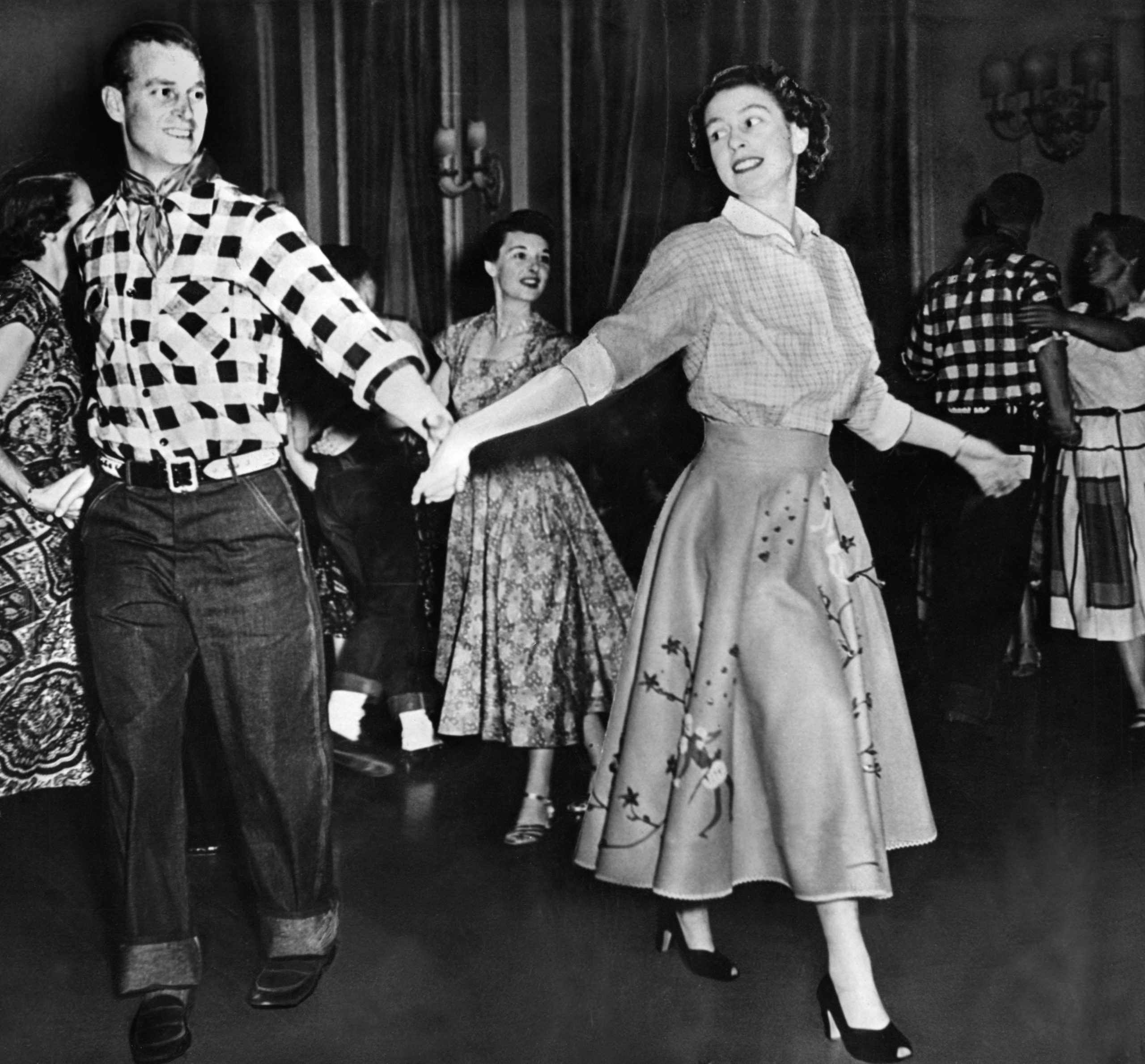 Queen Elizabeth II and Prince Philip square dancing at Rideau Hall, October 1951.