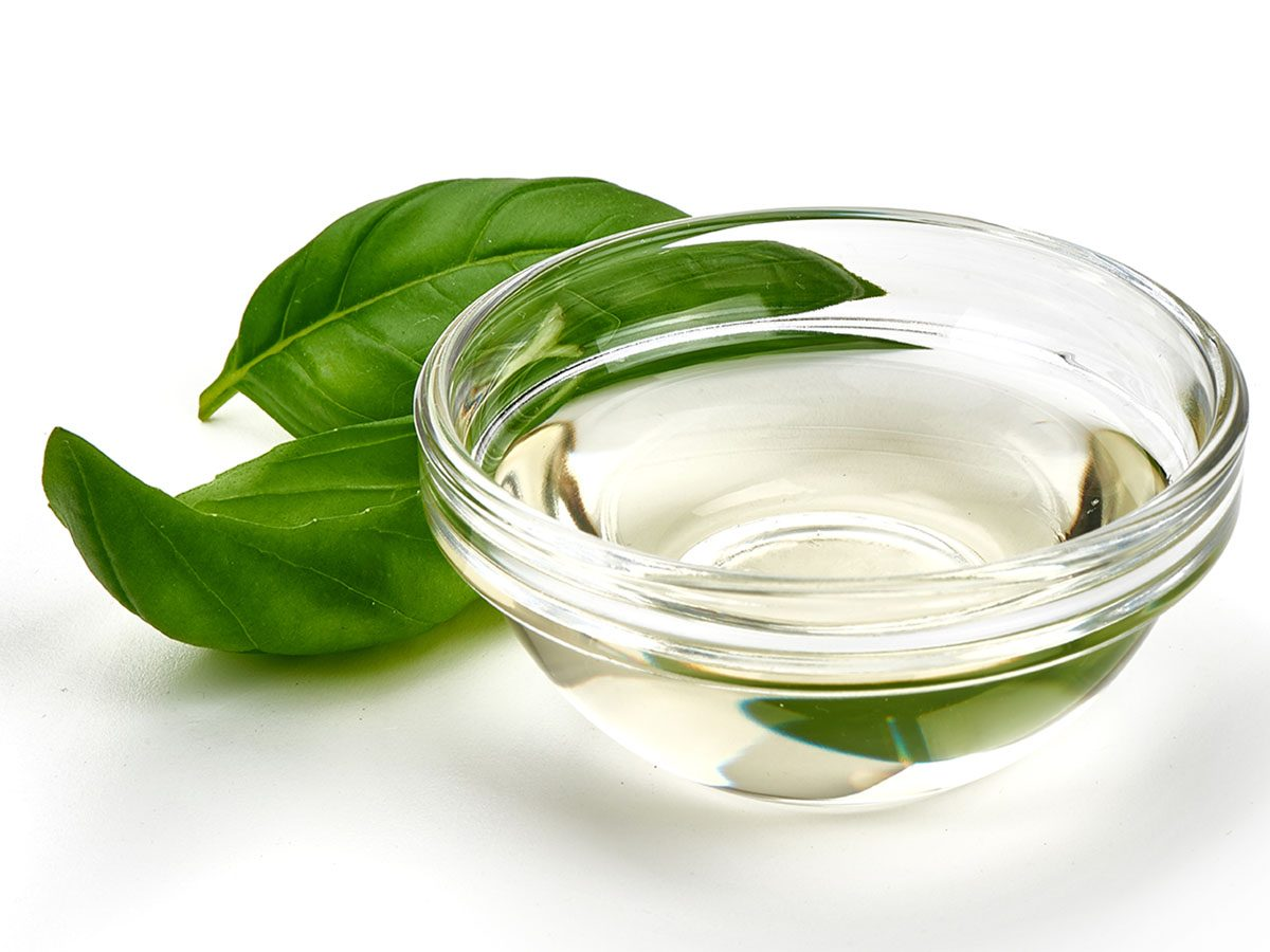 bowl of vinegar with basil.