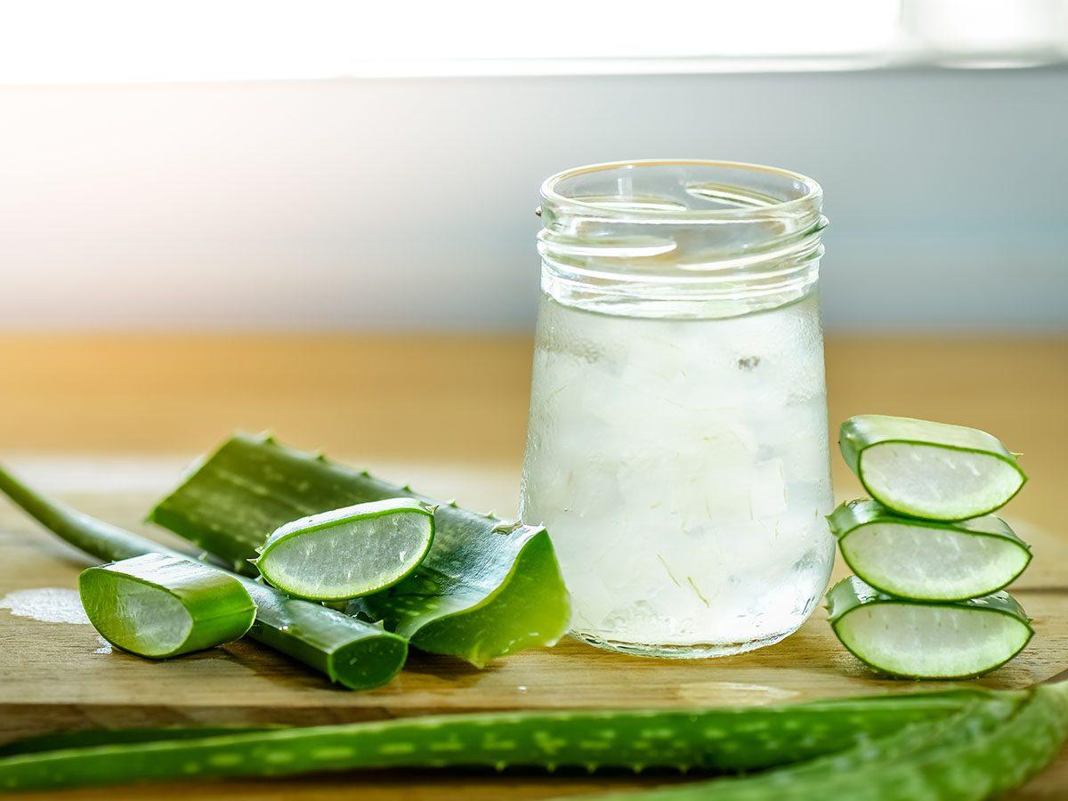 fresh aloe vera leaves and glass of aloe vera gel.