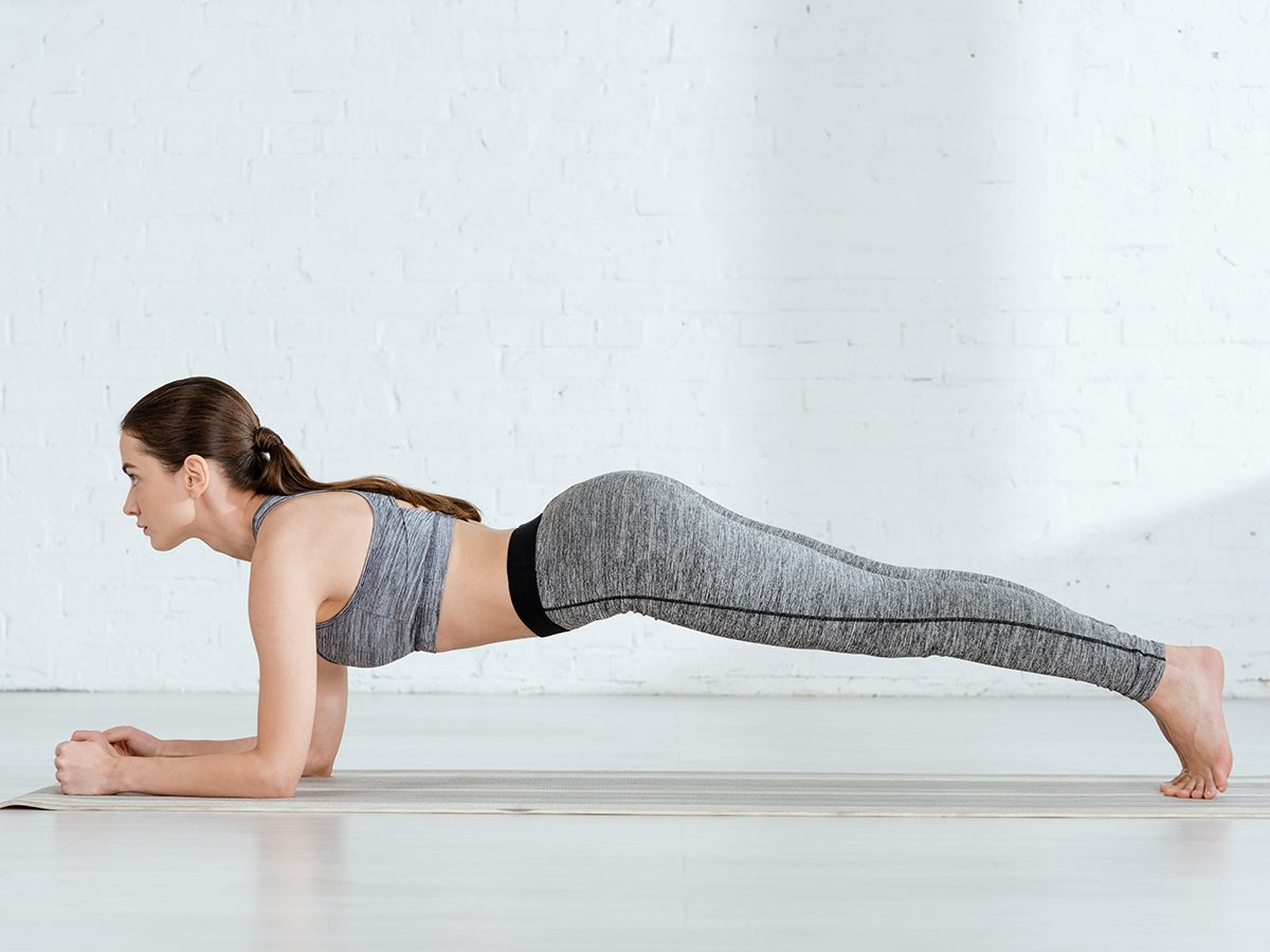 Woman practicing yoga in forearm plank pose