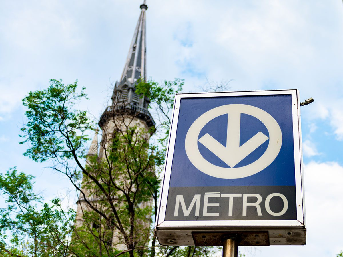 Montreal Quebec Canada metro sign beside church.