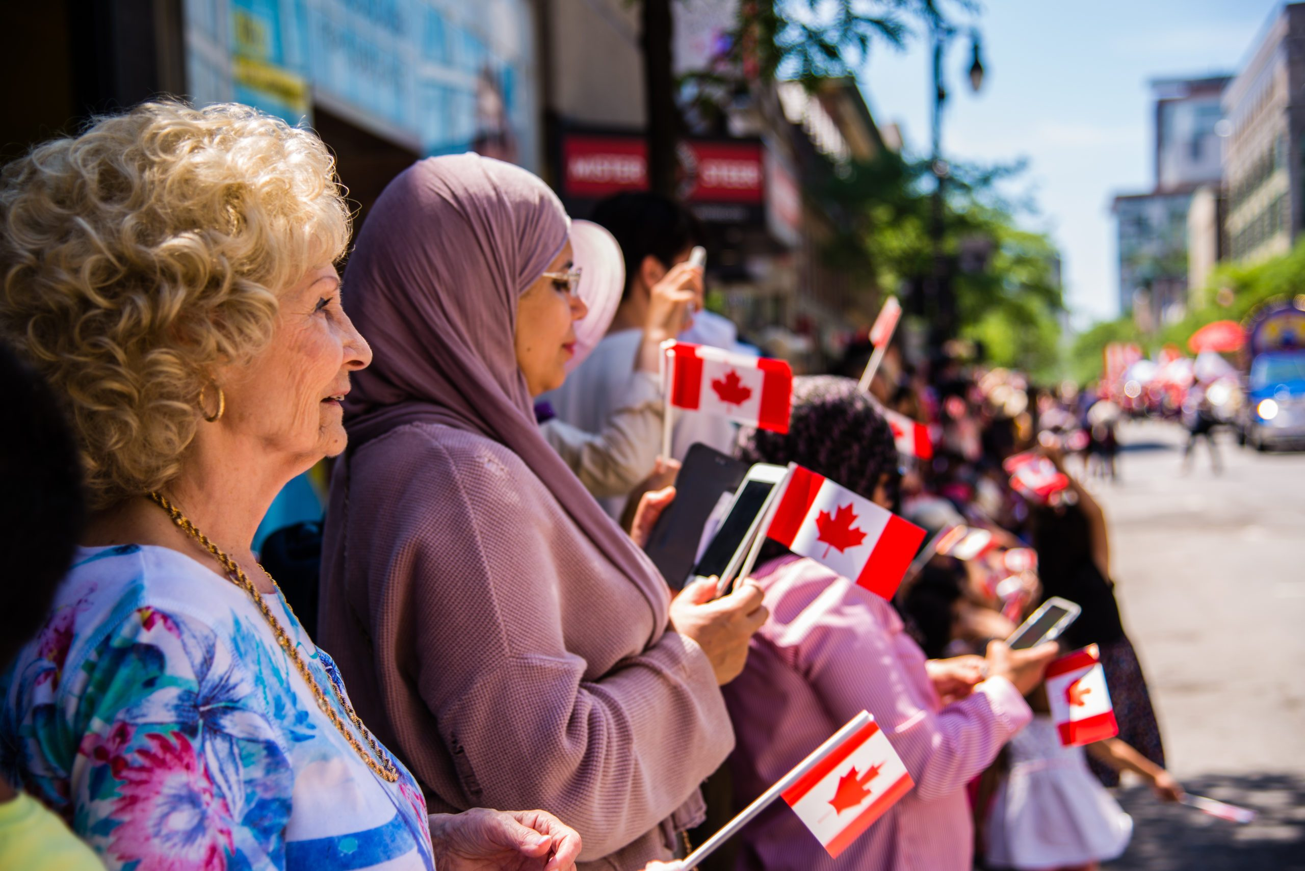 People gathering at downtown Montreal watching the Canada Day Parade.