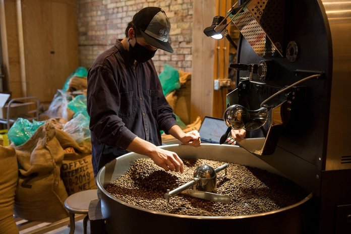 Roasting beans at the Rooftop Roasters cafe