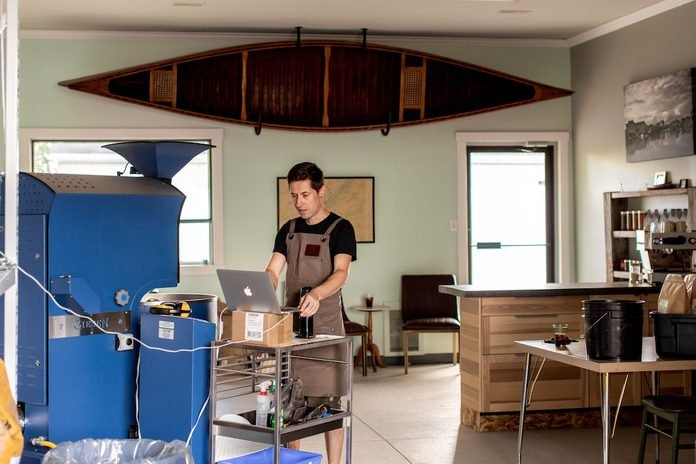 Roasting coffee beans at Rapids End cafe in Ontario.
