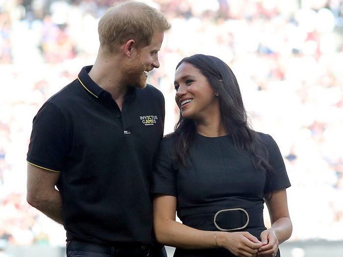 LONDON, ENGLAND - JUNE 29: Prince Harry, Duke of Sussex and Meghan, Duchess of Sussex accompany Invictus Games competitors on the field for the ceremonial first pitch before game one of the London Series between the New York Yankees and the Boston Red Sox at London Stadium on Saturday, June 29, 2019 in London, England. (Photo by Alex Trautwig/MLB via Getty Images)