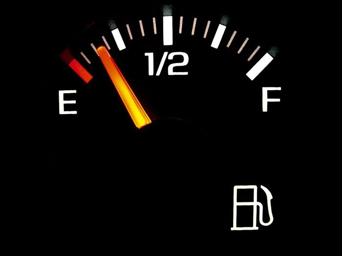 Car gas gauge nearing empty