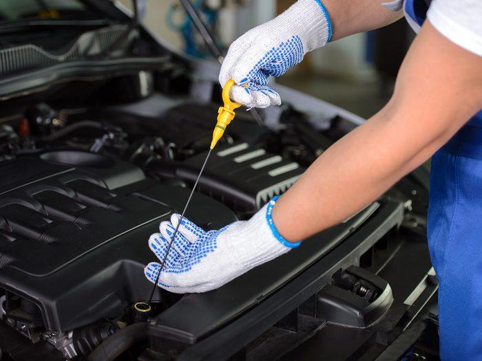 Checking car fluids in spring - checking dipstick