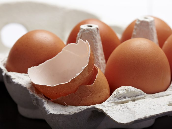 One crushed egg in carton of eggs