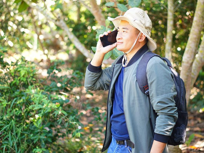 hiking for beginners - hiker on cell phone