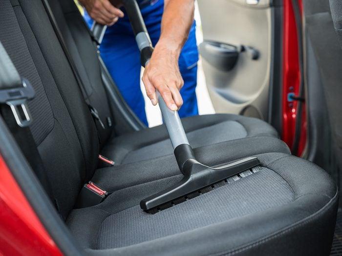 Vacuuming rear seat of car