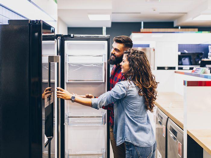 Appliance shortage - young couple buying new fridge