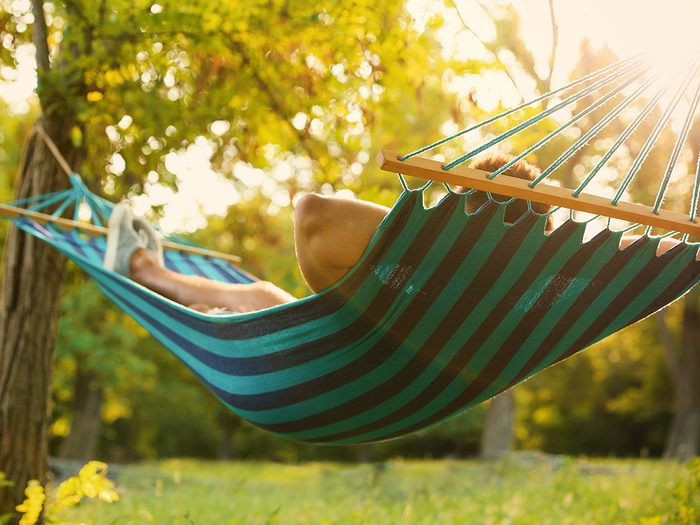 Best Canada hammocks - person lying in backyard hammock