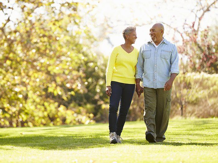 Best exercises for arthritis pain relief - senior couple walking in park