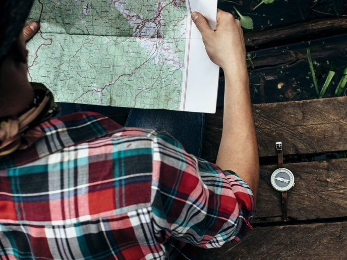 Hiking for beginners - Hiker planning route on map