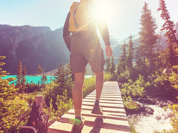 Hiking for beginners - man hiking on mountain trail