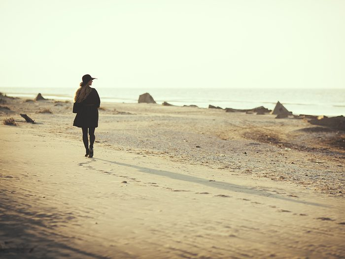How to be brave - woman walking alone on beach
