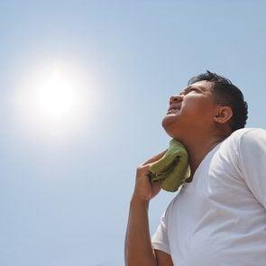 Signs Of Heat Stroke - Man Sweltering In Sun