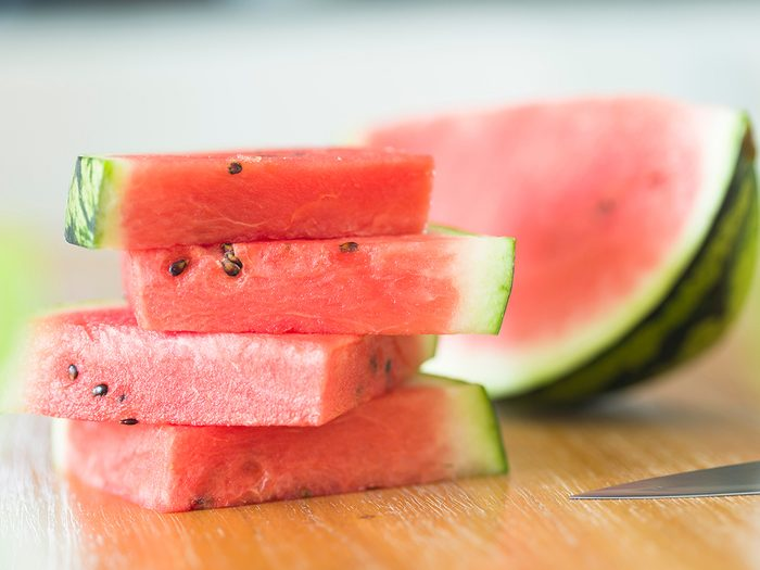 Watermelon pizza tiktok - Slices of watermelon on a wooden table, closeup of sliced watermelon
