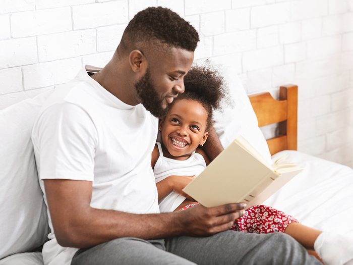Benefits of reading aloud - man reading to daughter
