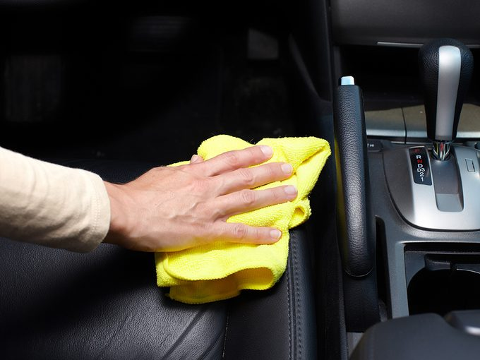 How to clean car seats - Hand cleaning car seat.