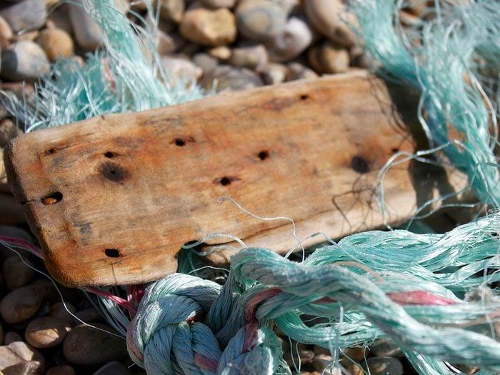 Ocean words - shipwreck debris on beach