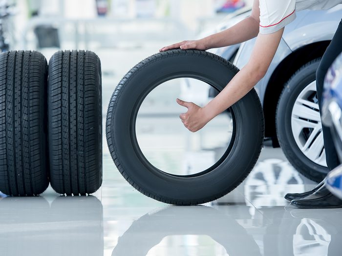 What numbers on tires mean - mechanic replacing tires