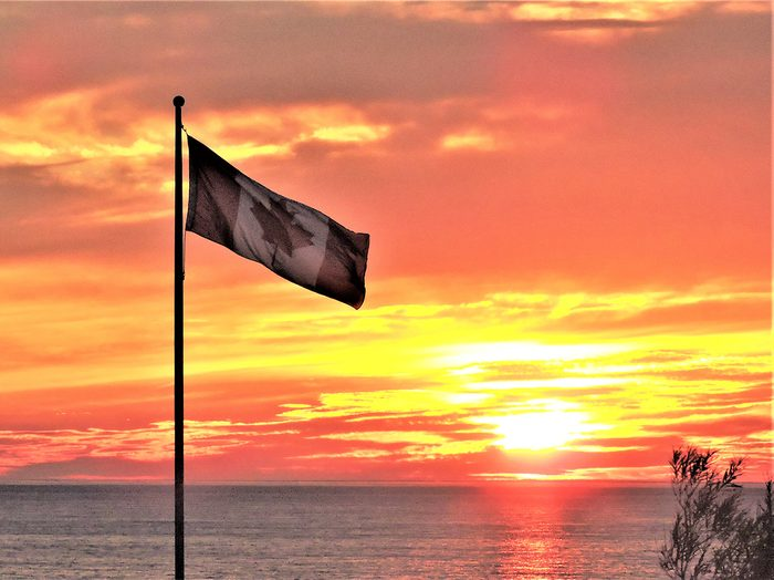 Sunset pictures - Canada flag at sunset