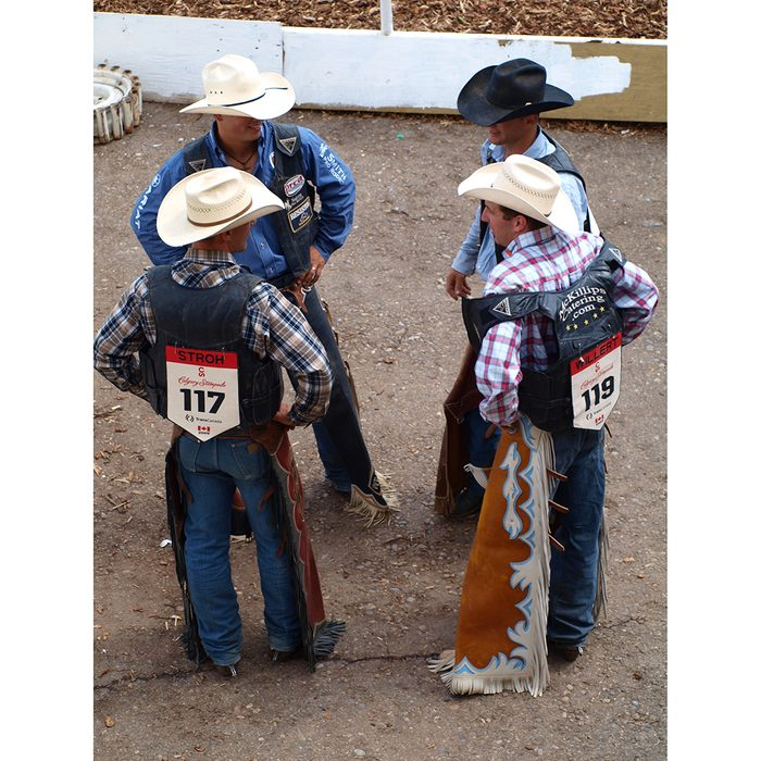 Candid photography - Calgary Stampede cowboys talking