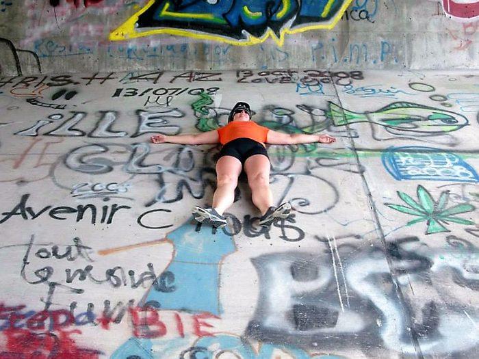 Candid photography - Lying on graffiti underpass