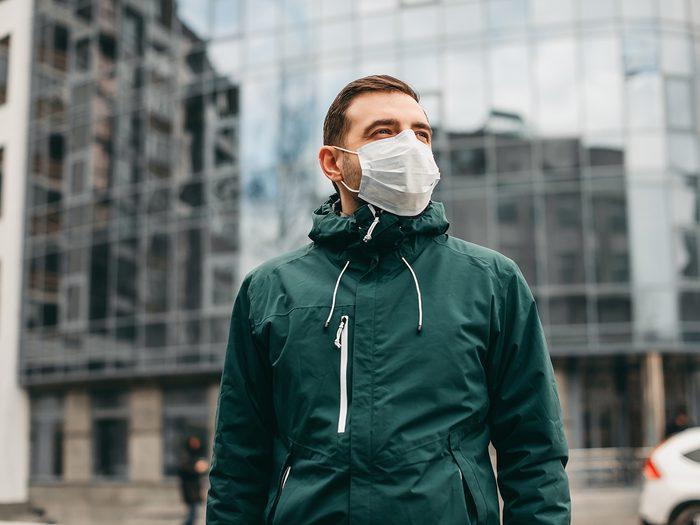 Delta variant - portrait of brunette man in a surgical mask