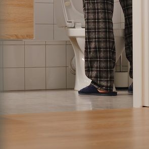 Get up to pee at night - man urinating in toilet