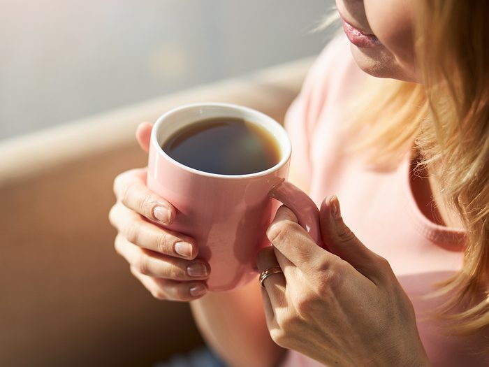 How much coffee is too much - woman drinking coffee from mug