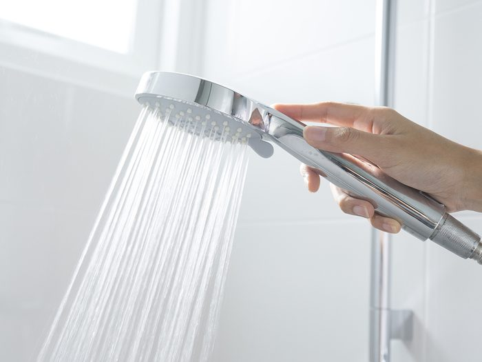 How often should you shower - shower head with hand
