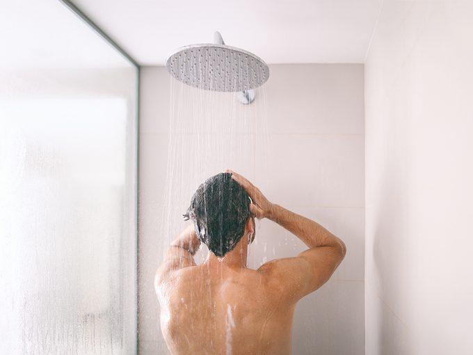 How often should you shower - Man in shower washing hair