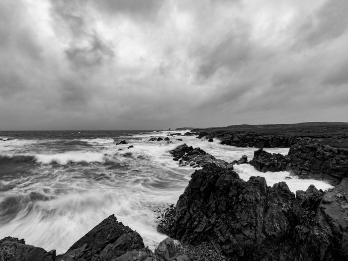 Natural disasters in Canada - hurricane reaching Newfoundland shore in black and white