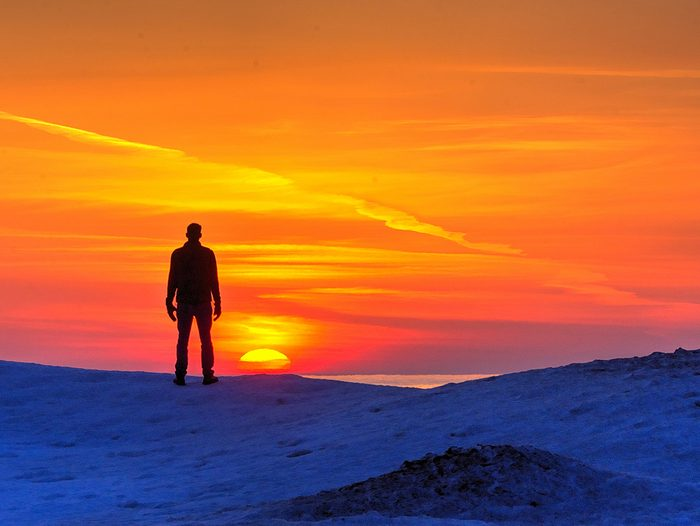 Sunset pictures - person standing silhouetted by sunset