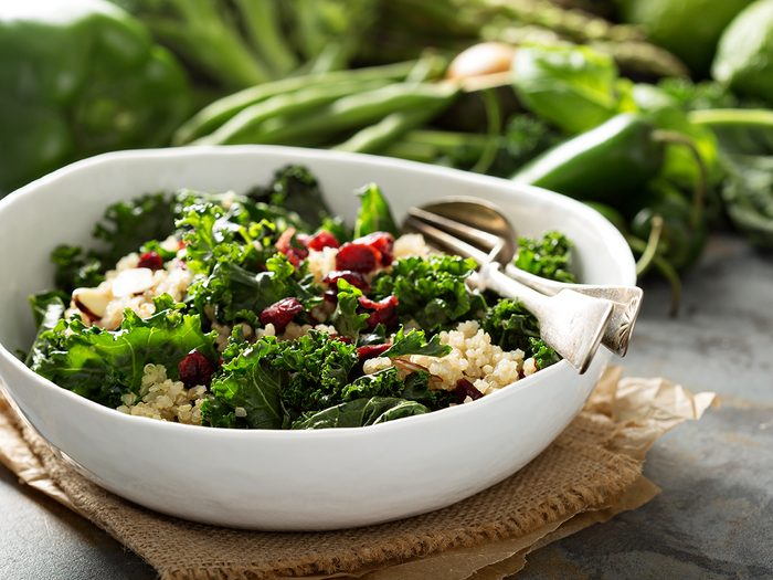 Best vegetables for weight loss - Healthy raw kale and quinoa salad with cranberry and almonds