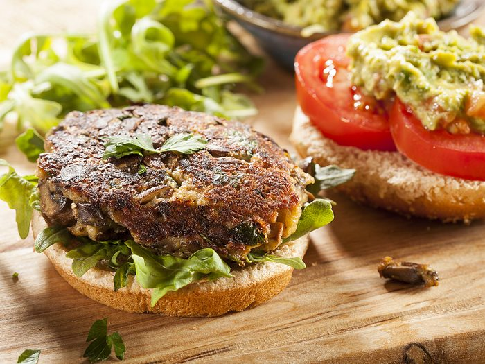Best vegetables for weight loss - Homemade Organic Vegetarian Mushroom Burger with tomato and guacamole