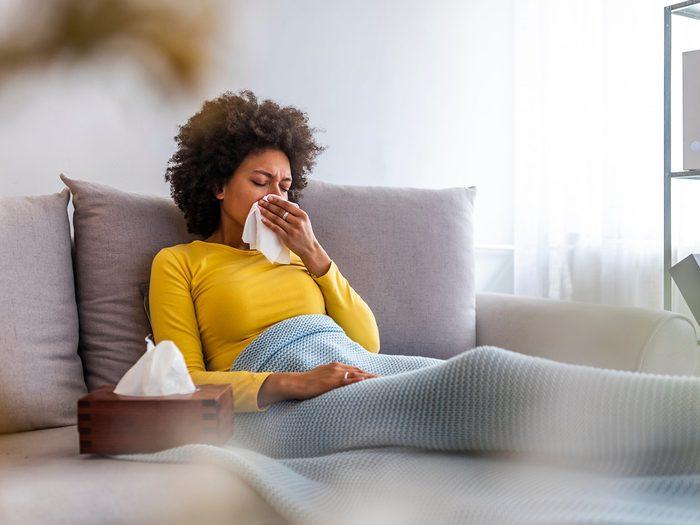 Flu Season 2021 - Woman Blowing Nose