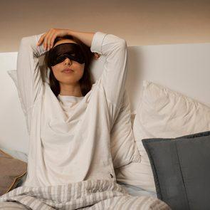 Sleep aids - Woman with eye mask getting ready to sleep