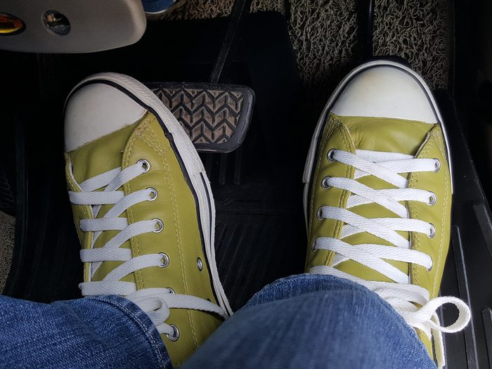 things you should never do to your car - Green shoes while drive car