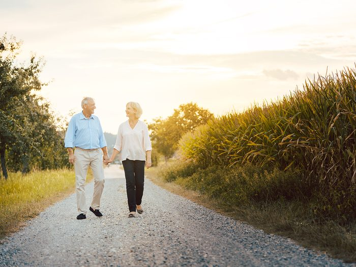 Everyday aches and pains - seniors walking outdoors