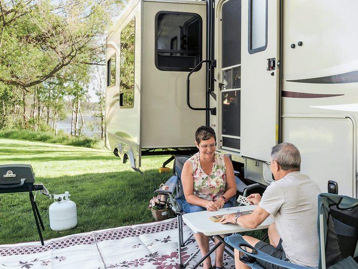 Darrel and Brenda Frisken with their fifth wheel trailer